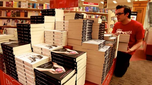 Grey area … Dymocks's Jack Bayfield loads up a display with books the retailer believes will appeal to Fifty ...