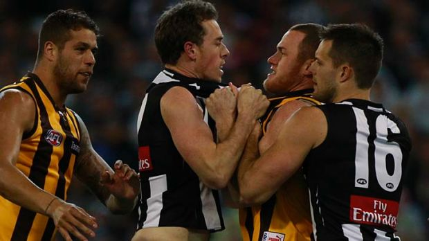 Nick Maxwell wrestles with Hawthorn's Jarryd Roughead.
