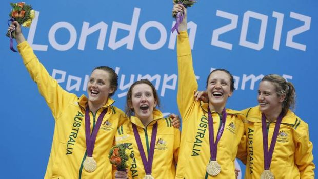 (L-R) Australia's Ellie Cole, Katherine Downie, Annabelle Williams and Jacqueline Freney celebrate winning gold for the ...