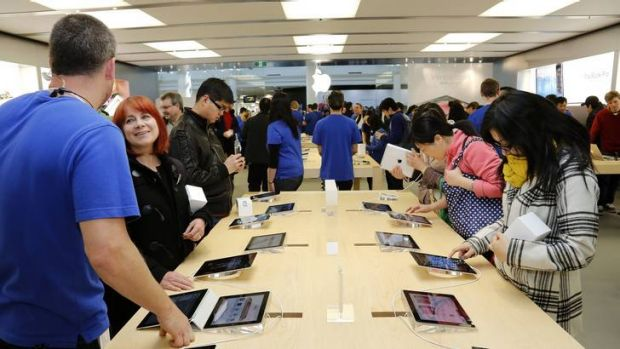 People inside the Apple Store at the Canberra Centre during the Grand Opening.