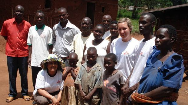 Kamalini Lokuge, wearing the hat, with other  Médecins Sans Frontières volunteers and a family in Uganda who lost 11 ...