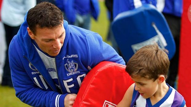 Top Roo: Brent Harvey at a Kangaroos' kids clinic last month.