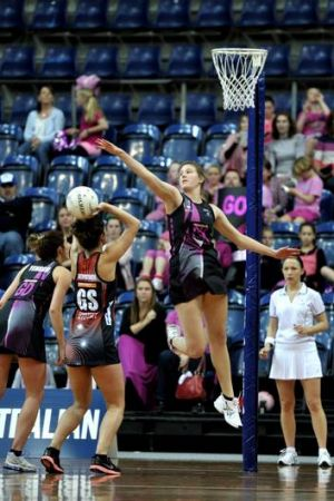 Canberra Darters' Shannon Priestly tries to block the shot from Territory Storm's Megan Fitzpatrick.