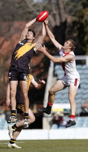 Queanbeyan player Roy Jaques takes a mark on Saturday.