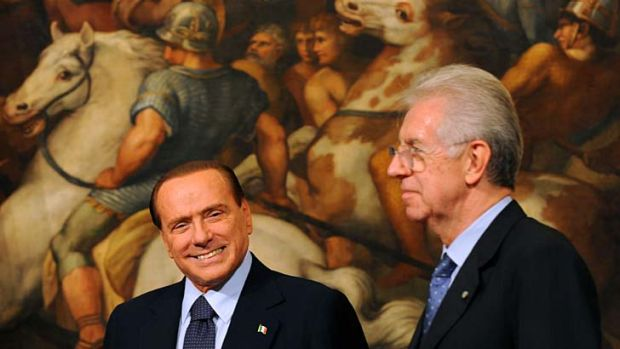 Italy's Prime Minister Mario Monti, right, and Silvio Berlusconi last year.