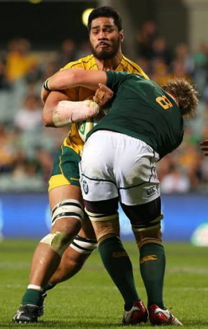 Sitaleki Timani of the Wallabies gets tackled by Duane Vermeulen of the Springboks on Saturday night.