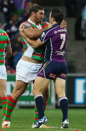 Angry … Dave Taylor faces up to Cooper Cronk.