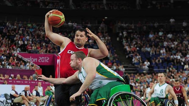 Roller ball: Shaun Norris blocks Canada's Joey Johnson.
