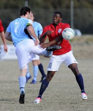 Canberra FC's Danai Gapare, right, was sent off against Belconnen United.
