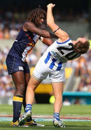Outmuscled … West Coast powerhouse Nic Naitanui swats away Kangaroos veteran Drew Petrie at Patersons Stadium.