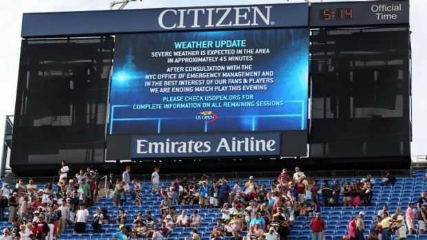 A severe weather warning posted on the big screens at the US Open in New York, where the men's semi-final had to be ...