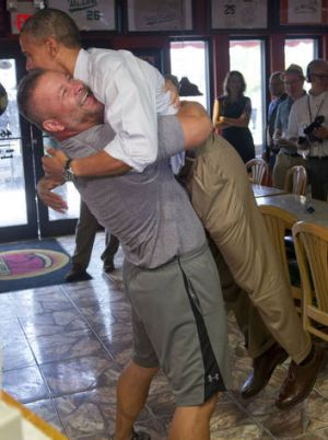 US President Barack Obama is picked up by pizza owner Scott Van Duzer during a visit to his restaurant in Fort Pierce, ...