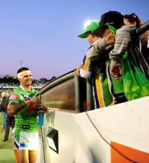 Raiders winger Sandor Earl with some young Canberra fans after the Sharks clash.