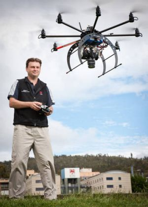 Darren Turner from the School of Geography and Environmental Studies with a drone.