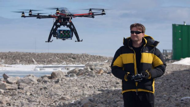 A researcher from the University of Tasmania  trialling a drone.