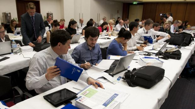Journalists pore over the figures in today's state budget lock-up.