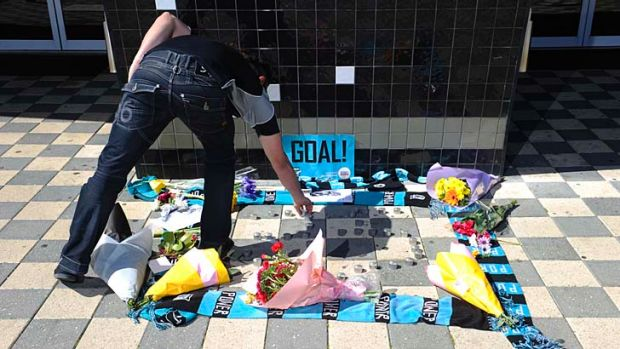 Flowers placed outside the Port Adelaide club in memory of John McCarthy.