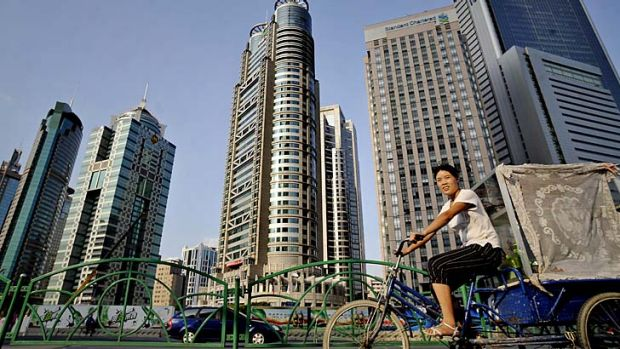 Focusing on returns: Pudong, the finance district of Shanghai.
