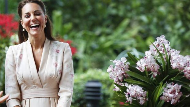 Reason to be cheery? Catherine, the Duchess of Cambridge, smiles during a ceremony in Singapore yesterday. Onlookers ...