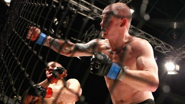 Robert Whittaker (left) sways out of the way of a Corey Nelson punch during their CFC 18 bout in Sydney last year. ...