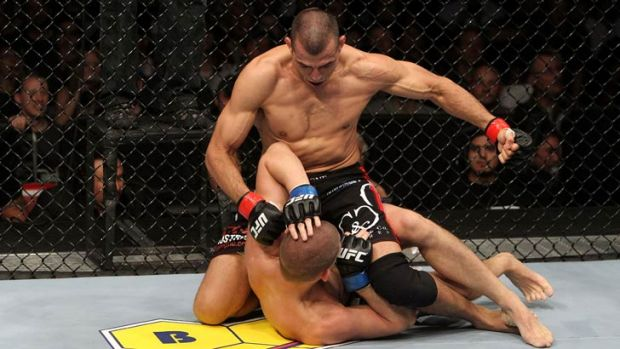 George Sotiropoulos (top) pounds his way to a UFC victory over Joe Lauzon in November, 2010.