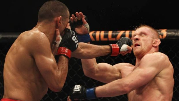 George Sotiropoulos (left) lands a punch during a 2011 loss to Germany's Dennis Siver.