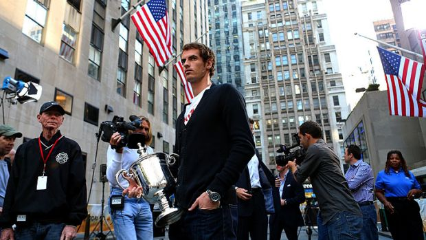 Smiling on the inside ... Andy Murray with his US Open trophy at a photocall in New York overnight.