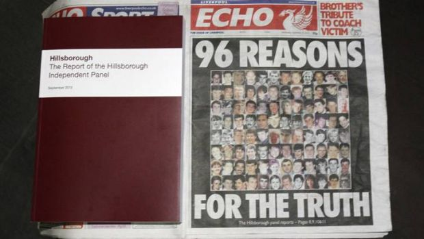 A copy of the report delivered by the Hillsborough Independent Panel is positioned next to a copy of the <i>Liverpool ...