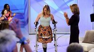 This image released by Disney-ABC Domestic Television shows host Katie Couric, right, applauding as Aimee Copeland, 24, ...