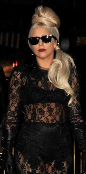 Lady Gaga in one of her guises - a far cry from the 'warts and all' photos displayed at </>Little Monsters</i>.