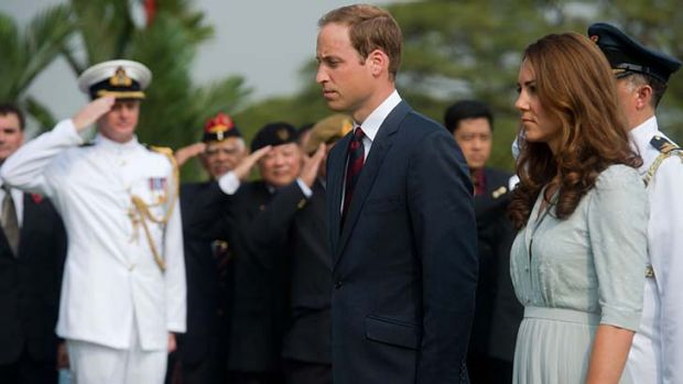 Is she or isn't she? ... the royal couple yesterday.