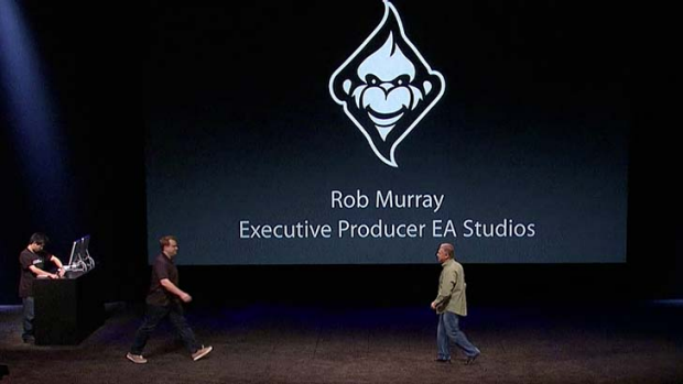 Rob Murray is greeted on stage by Apple's senior vice president of worldwide product marketing, Phil Schiller.