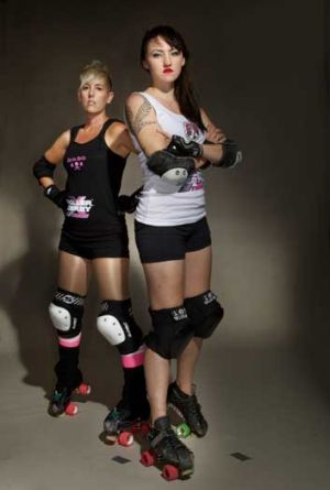 Let it roll: roller derby competitors Gori Spelling, left, and Fisti Cuffs in Melbourne.