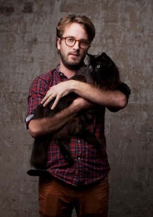 Looking for a hot tin roof … Ralph Myers, Belvoir's artistic director, with Nealksy the cat.