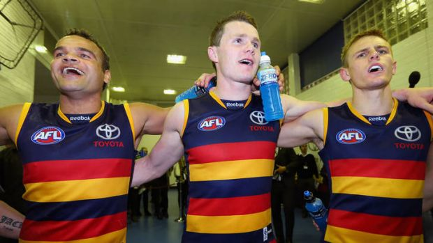On song: The Crows celebrate their victory last night.