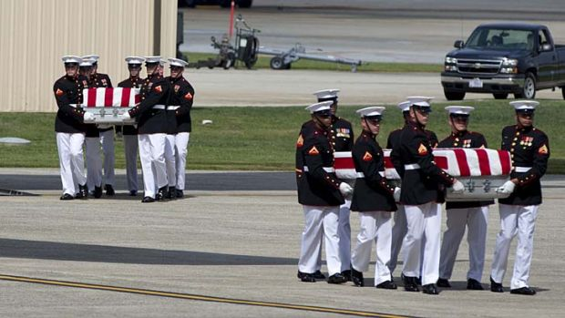 The bodies of the four Americans killed in Benghazi arrive home.