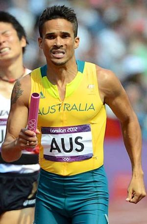 Combative … John Steffensen takes the baton in the 4x400m relay at the London Games.