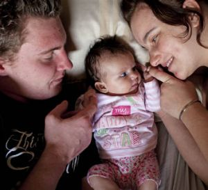 'I never thought i would be a mum this young but I'm doing the best I can.' Hannah Dickens, with partner Trent Lines and ...