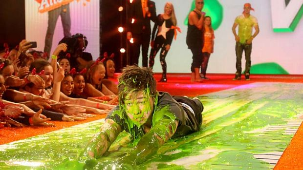 Slime time ... singer Reece Mastin slides in some green goo.