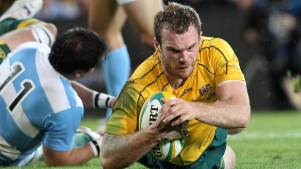 Comeback ... Pat McCabe scores the try that triggers the Wallabies' comeback against Argentina.