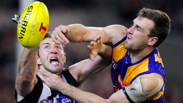 Front line smothered ... Travis Cloke battles West Coast's Eric Mackenzie for the ball during Collingwood's tough win ...