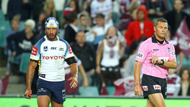 Blunder ... Johnathan Thurston is upset with the referee's controversial decision to award a try.