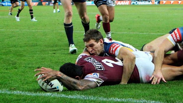 Riding his luck ... this Jorge Taufua try was one of two controversially awarded to Manly on Friday.