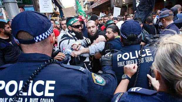 Protesters clash with police in Sydney during protests against an anti-Islamic film.