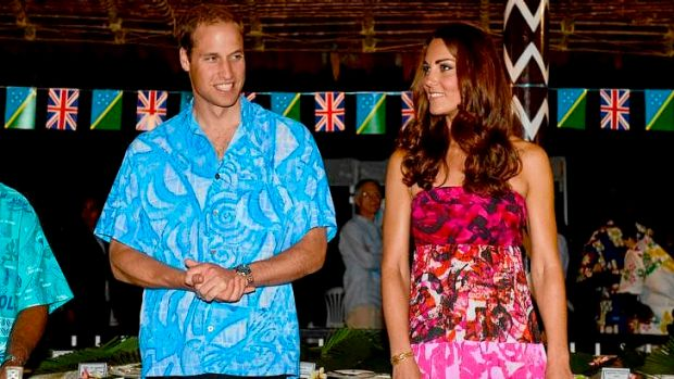 Britain's Prince William, left, and his wife Kate prepare to sit for a meal at Government House in Honiara, Solomon ...