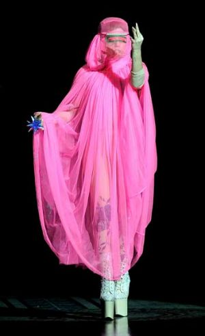 Lady Gaga acted as MC for Phillip Treacy, donning a neon veil and sky-high McQueen heels to do so.