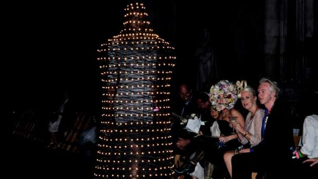 Lady Gaga watches on at  Phillip Treacy's London Fashion Week show. Her floral number had some tough competition on the ...