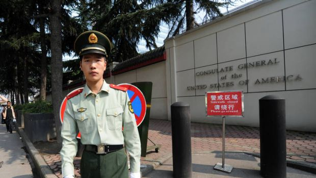 A Chinese paramilitary policeman stands guard at the entrance of the US consulate in Chengdu.