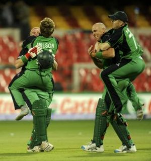 Giant killers ... Irish cricketers celebrate victory over England in their 2011 World Cup match in Bangalore.