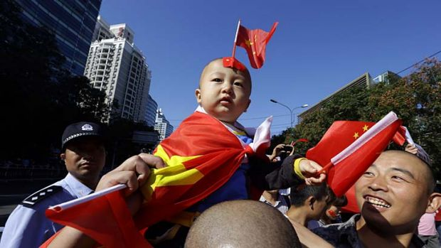 Cool heads ... the US has called for calm as protesters marched outside the Japanese embassy in Beijing yesterday on the ...